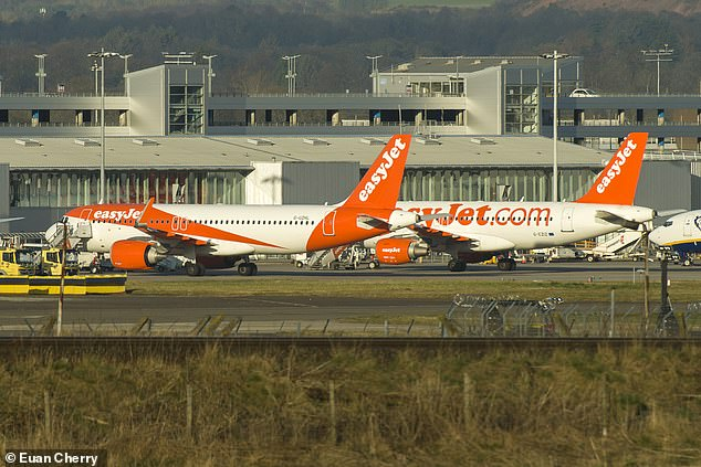 EasyJet planes are seen stranded at Edinburgh Airport this morning, while all its flights over 1,000 are closed for at least two months