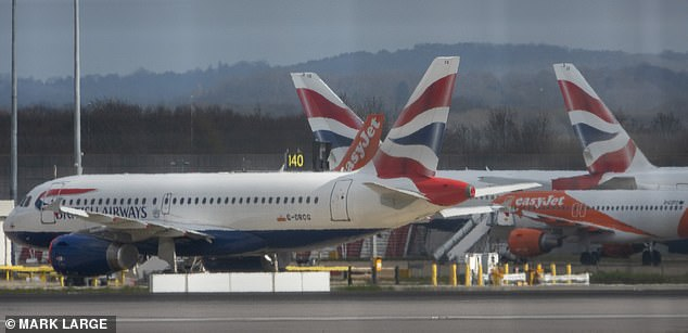 British Airways today axed all its flights to and from Gatwick (its grounded jets pictured there today) as the aviation industry continued to collapse because of coronavirus