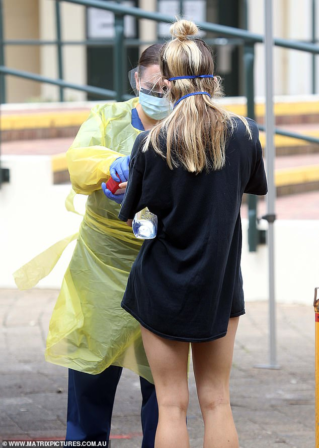 The Melbourne Market Authority released a statement announcing they would continue to remain open despite the positive test result (Pictured: a woman being tested for coronavirus on Wednesday)