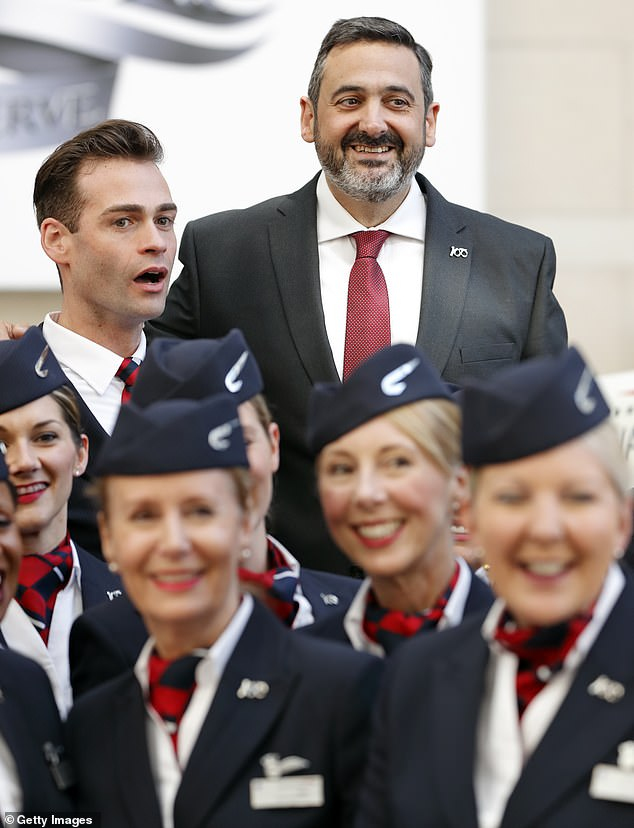 Two weeks ago, British Airways admitted that the coronavirus was threatening its very survival, as staff were informed that there would be layoffs and that the planes should be put on hold due to the worsening of the global pandemic (Alex Cruz, President and CEO of British Airways, poses for a photo with British Airways Staff last year)