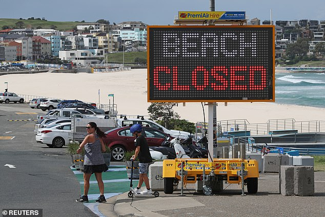 While most beaches around the country remain open, at some high-density shorelines such as Bondi (above), the sand and surf is off limits