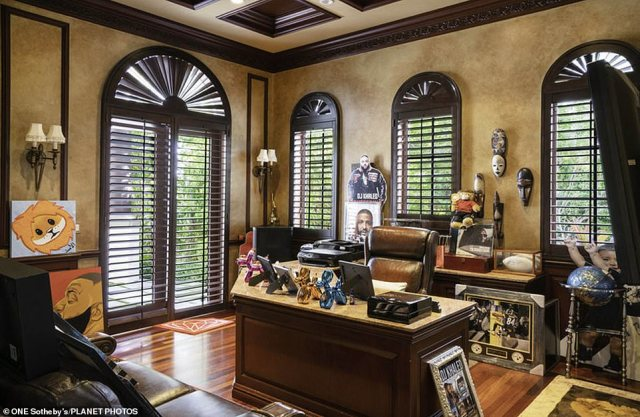 So many pictures of the DJ! Here is his office which had many images of himself as well as a few masks and toys