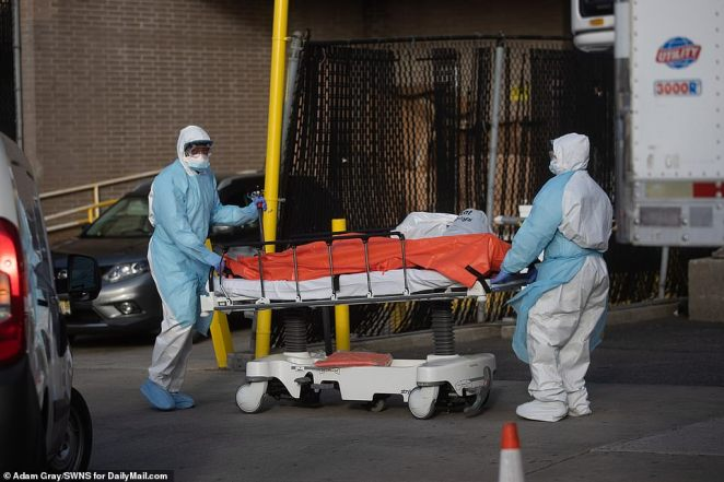 Bodies are loaded onto a refrigerated truck outside of Wyckoff Medical Center in Brooklyn, NYC, Thursday as the number of victims from coronavirus continues to grow and deaths in the United States reach over 6,000