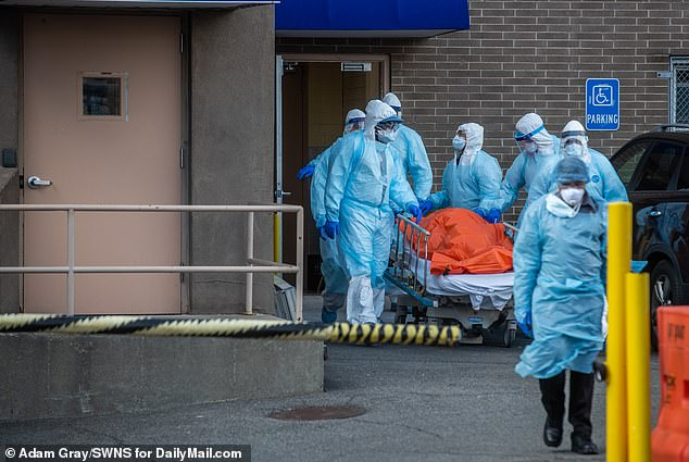 Bodies are loaded on a refrigerated truck outside the Wyckoff Medical Center in Brooklyn Thursday