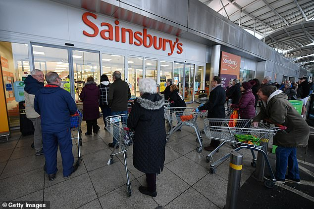 Supermarket giant says if more than one adult arrives at one of its stores, staff will ask the group to choose who goes inside to do their shopping, with the rest waiting outside