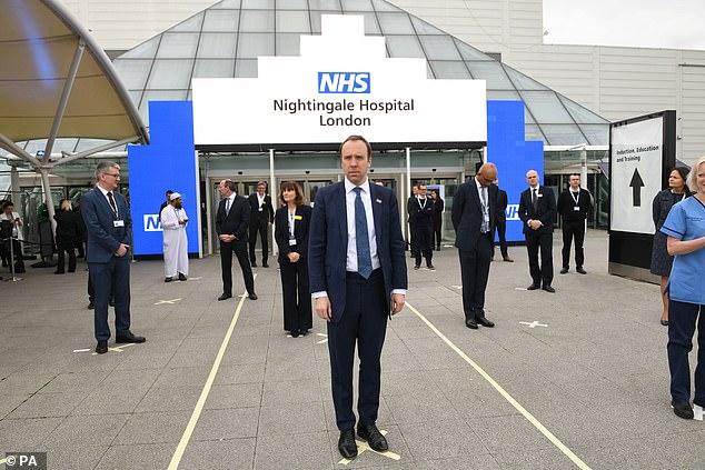 Secretary of Health Matt Hancock's plan is in serious doubt due to the lack of essential test equipment, including chemical reagents, test tubes and swabs. He is pictured in the center during the opening of the NHS Nightingale Hospital in London