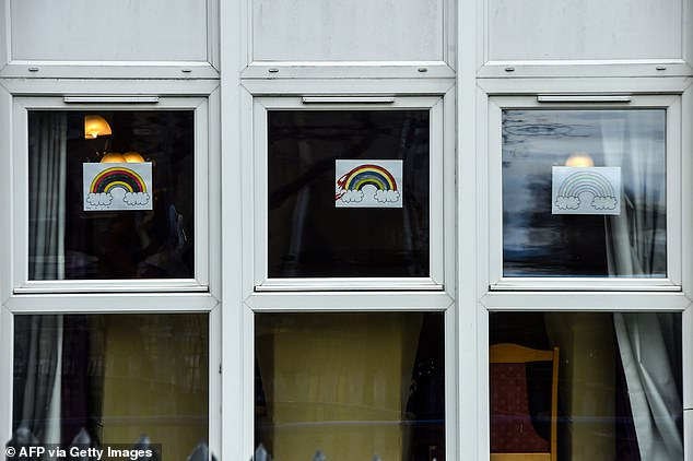 Rainbow photos, offering messages of hope to the public, are seen in the windows of the Burlington Court Care foster home in Cranhill, in the East End of Glasgow, April 4, 2020.