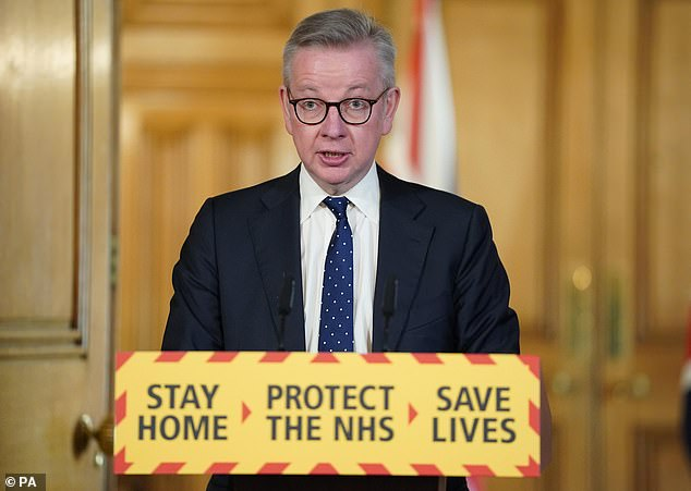 Michael Gove pictured during a press conference on coronavirus in Downing Street today. Mr Gove, using different statistics to those put out by the Department of Health, said 10,984 people were tested on Friday