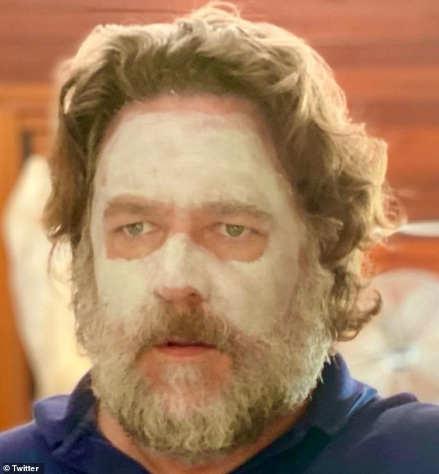 The return of 'skincare man': Hollywood actor Russell Crowe (pictured) treated fans to a rare selfie of his morning beauty routine on Sunday, which saw him wearing a white face mask