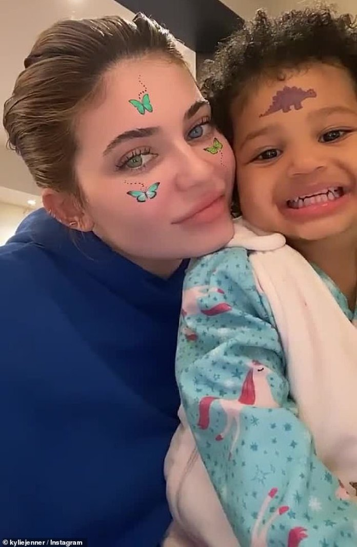 Kylie Jenner's daughter Stormi, two, sticks her tongue out as she ...