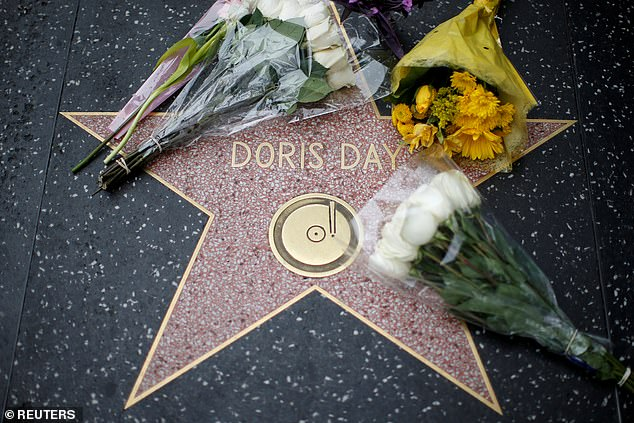Flowers are pictured by the star of late actor Doris Day on the Hollywood Walk of Fame in Los Angeles, California (File image)