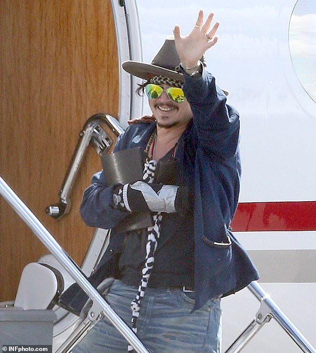 Depp also claims in a series of clips that he `` protected '' Heard in the aftermath of the March 2015 dust, claiming that he trapped him in a door when the horrific injury occurred when she threw a bottle of vodka on him. '' Pictured: Depp waving with his other hand wrapped as he returned to the United States for post-combat surgery