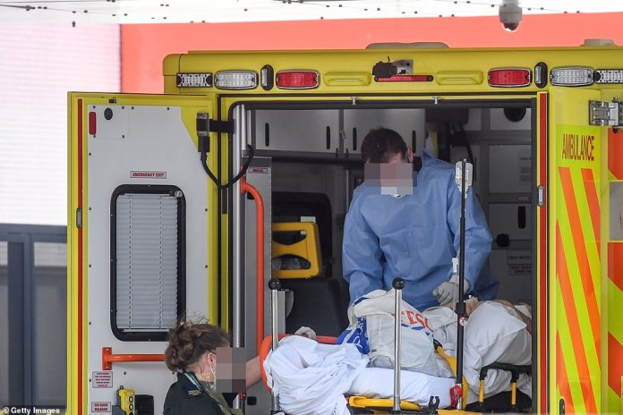 Medical personnel are pictured in an ambulance outside St Thomas Hospital in London, where Prime Minister Boris Johnson is treated