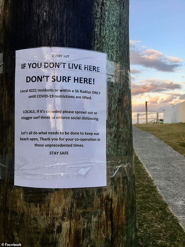 This sign was taped to a tree at Palm Beach, Queensland, south of Surfers Paradise