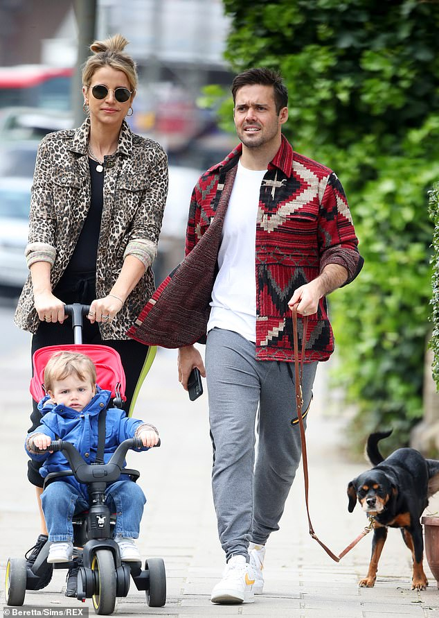 Chic: Vogue looked lovely wearing a leopard print jacket worn with a black top and matching leggings for the daily outing