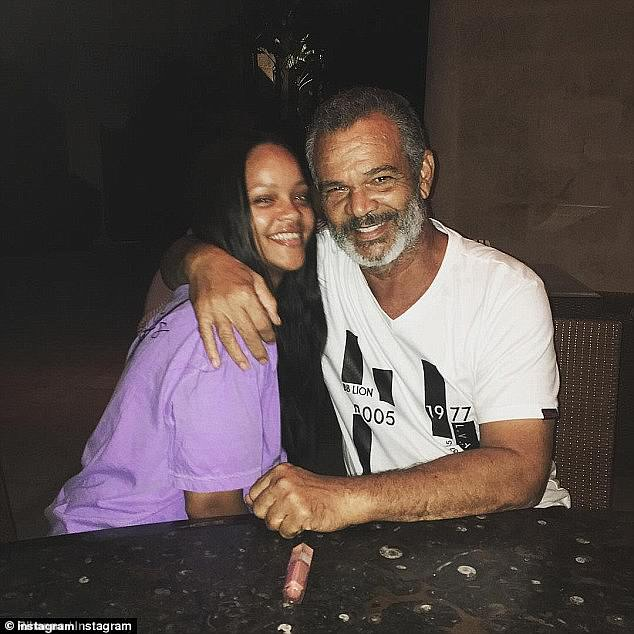 Got his back: Rihanna's dad Ronald Fenty 'thought he would die' after being stricken by coronavirus; the two are seen in a a file picture