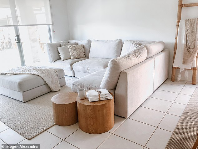 While much of Imogen's furniture is white (living room pictured), she said one of her top tips is to buy machine-washable furniture so you can always put it around the wash