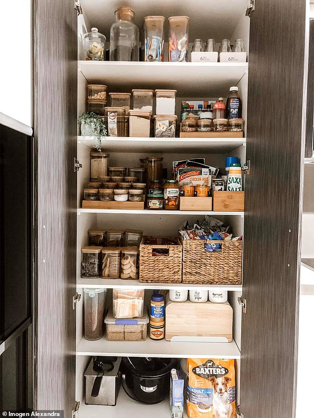 Imogen labelled her Kmart containers with labels from Labelled with Vinyl, and she said she has expensive taste, but the majority of what she buys is from Kmart and IKEA (pantry pictured)