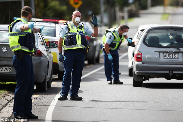 With New Zealand in lockdown due to COVID-19, police (pictured on Thursday in Warkworth) are setting up checkpoints to ensure people on the roads are travelling for essential purposes