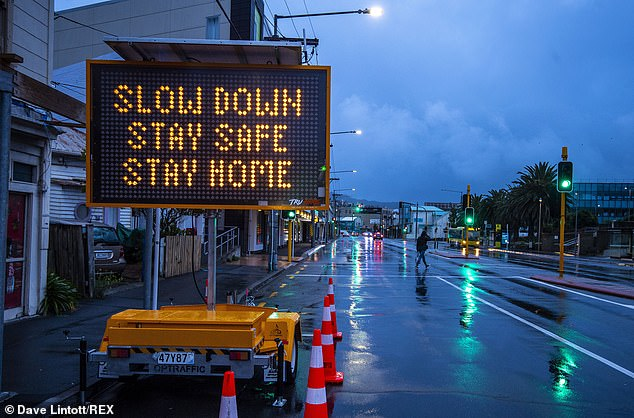 A sign telling New Zealanders to 'stay home' is displayed by the side of a road in Wellington today