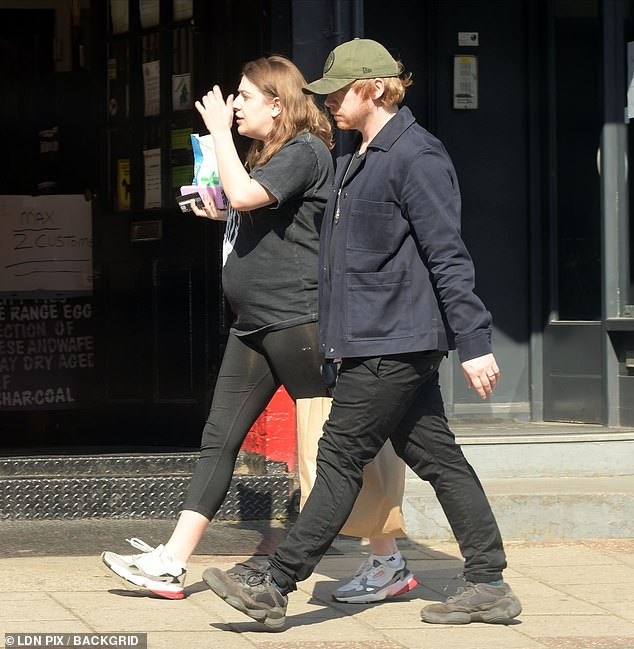 Loved-up: Harry Potter actor Rupert Grint, 31, and his partner Georgia Groome, 28, stocked up on supplies as they dated North London amid COVID-19 lockdown