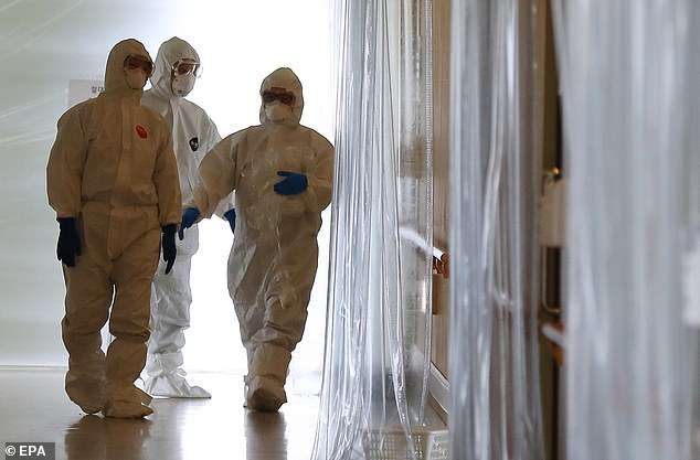 Medical staff ventilate an empty room in a hospital in the city of Daegu in south-eastern South Korea
