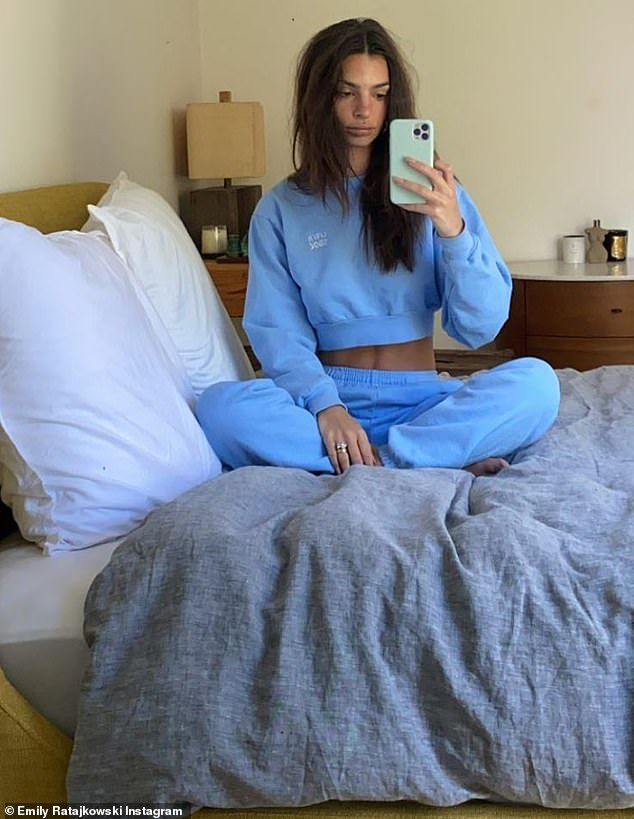 Relaxation: she modeled the same outfit when she lay on her cross-legged bed and took a mirror selfie for her Insta Stories
