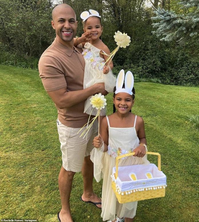 Happy families: Rochelle Humes, 31, posted a nice photo of her husband Marvin, 35, with their daughters Alaia-May, 3, and Valentina, 6, all dressed in a sweet yellow dress