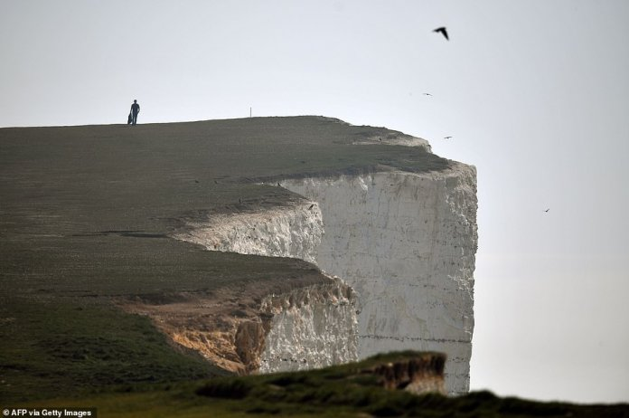 People are still heading to Beachy Head in Eastbourne on Sunday. People are allowed to go out for walks as part of their daily exercise for one hour