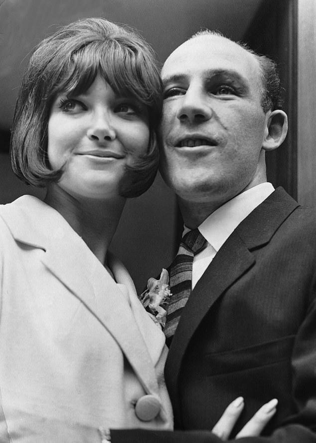 Stirling Moss is pictured with his second wife Elaine on their wedding day in June 1964