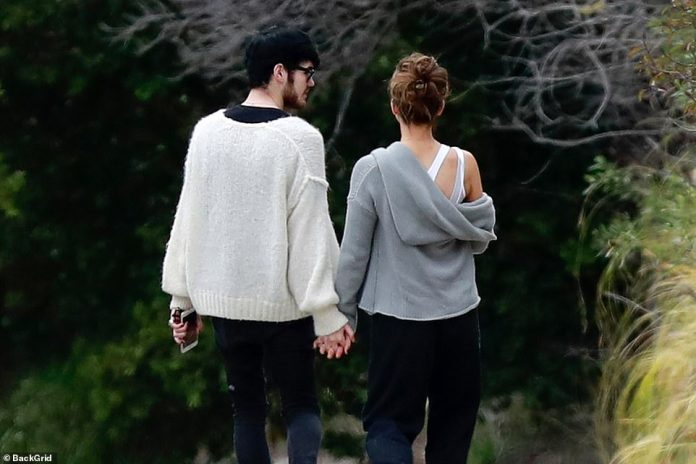 The look of love: Goody looked at Beckinsale during their leisurely stroll