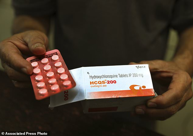 Scientists in Brazil halted part of a study of the malaria drug presented as a possible treatment for coronaviruses after heart rhythm problems developed in a quarter of people given the higher of the two doses tested . Pictured: chemist from New Delhi, India, displays hydroxychloroquine pills (AP Photo / Manish Swarup, File)