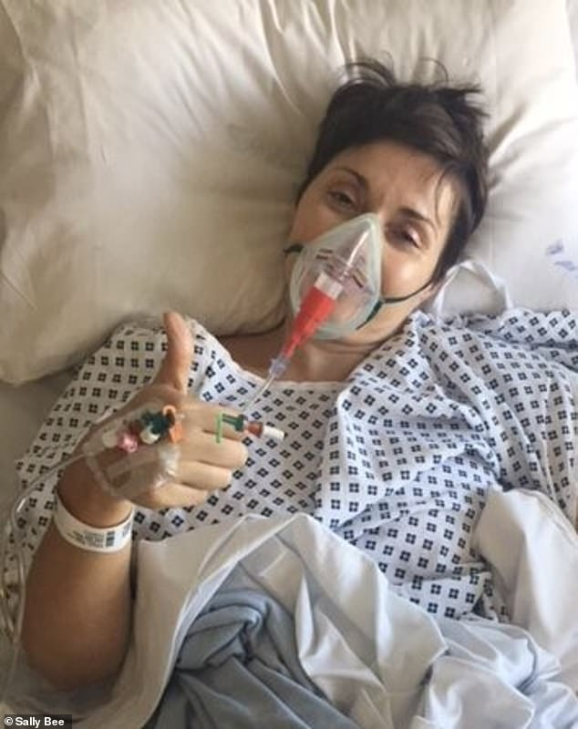 Sally has survived five heart attacks - three of which happened at the age of 36 - and her family were told to say their goodbyes as she wasn't expected to survive. Pictured in hospital after her fourth and fifth heart attack