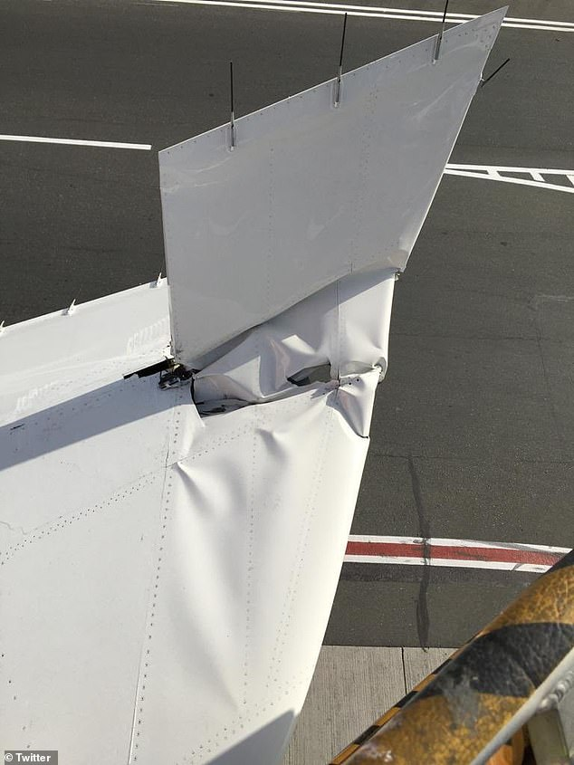 Pictured: The damage to the Emirates Boeing 777's horizontal elevator on Dubai airport's runway on Monday night