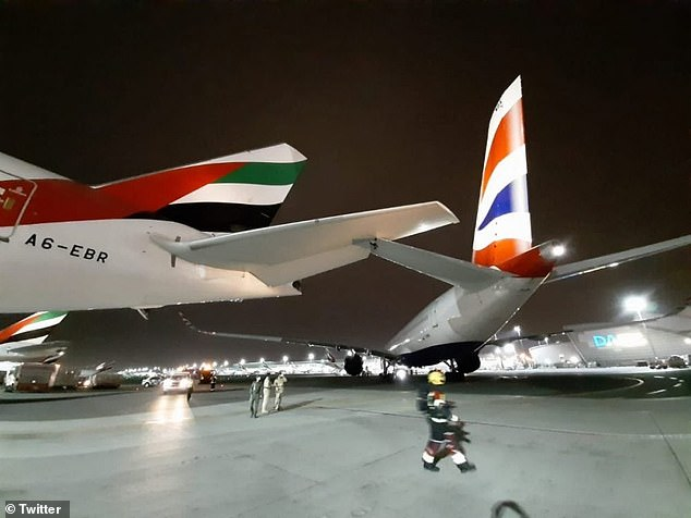 Pictured: The two planes at the time of collision on the runway of Dubai airport on Monday night