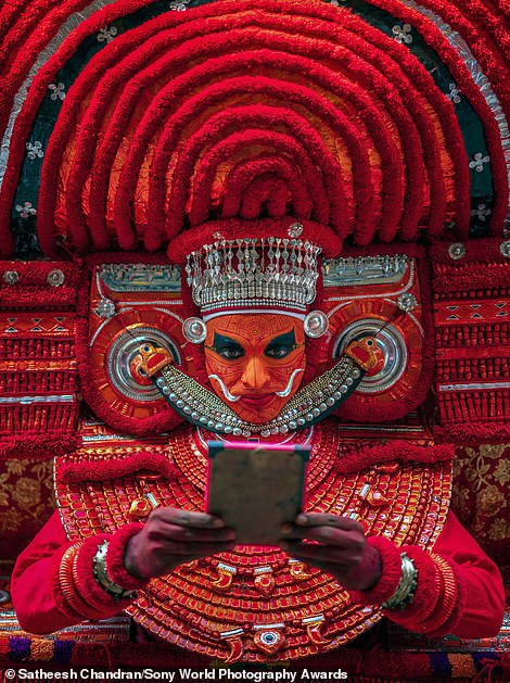 Satheesh Chandran, from India, snapped this shot of a Theyyam ritual taking place in a temple in Kerala, which was shortlisted in the culture category. The photographer said: 'The performer transforms from human to a demigod through music, dance, make-up and costume'