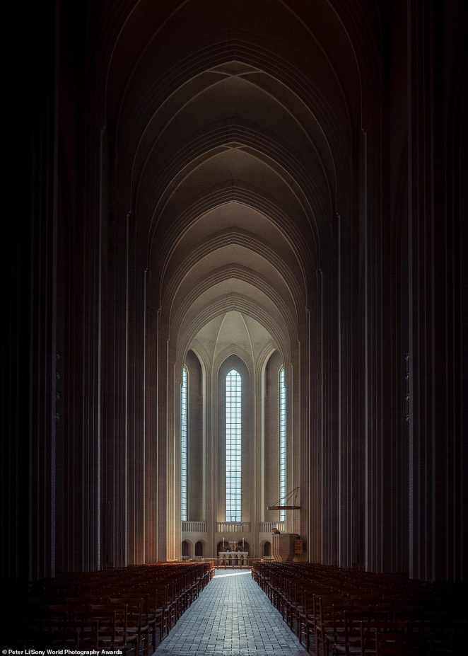 British photographer Peter Li was shortlisted in the architecture category for this haunting photo of Grundtvigs Kirke, a relatively new church in Copenhagen. Peter said: 'It was completed in 1940 and took the architect's family three generations to complete. The design is a fusion between the modern geometric forms of Brick Expressionism and the classical vertical structure of Gothic architecture'