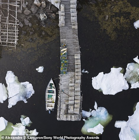 Canadian Alexandre B. Lampron captured this image in the spring of 2019, It shows a Newfoundland cove overrun by sea ice. He said: 'The fishermen were waiting for an opportunity to go out between tides to lay their lobster traps.' The image was shortlisted in the architecture category