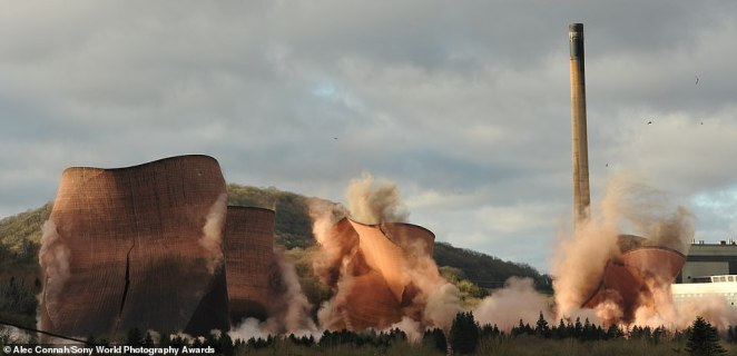 Alec Connah from the UK was named as the winner of the motion category thanks to this shot showing the demolition of four cooling towers at Ironbridge Power Station in Shropshire. He said: 'The towers had been a feature of the landscape for 50 years, but were brought down as part of a new development on the site. The demolition had been a long time coming - the towers were close to a river, railway line and protected woodland, so their destruction had to be precise. This picture was taken from my garden, which is on the hillside opposite the site'