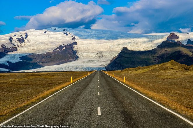 American photographer Kaitlyn Kamperschroer captured this stunning shot while travelling around Iceland in August 2019. It was shortlisted in the travel category. She said: 'My only plans were to drive and explore. While travelling along Route 1 (Iceland's Ring Road) I was stunned by the endless landscape before me. I pulled over at a stopping point and captured this image of the road and Svínafellsjökull Glacier'