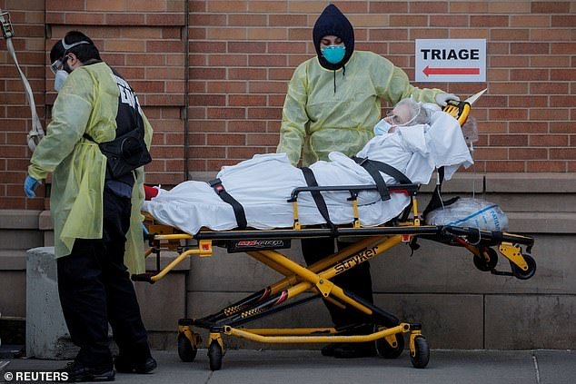 Paramedics take a patient into an emergency center in Brooklyn, in New York where the world's largest outbreak has been centred