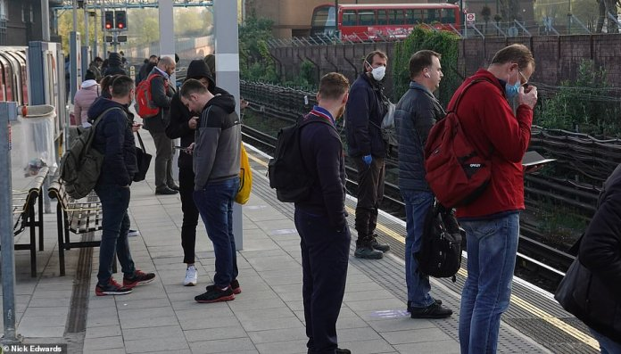 Although Boris Johnson said the public should stay home, many are still forced to travel in packaged tubes. In the photo above, people are climbing into the tube this morning at Leytonstone