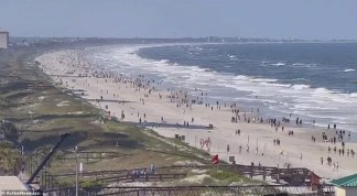 Florida Beach is Crowded Within 30 Minutes of Reopening at 5pm, Despite State Recording Its Highest One-day Increase Since the Coronavirus Plague Began with 1,413 New Cases
