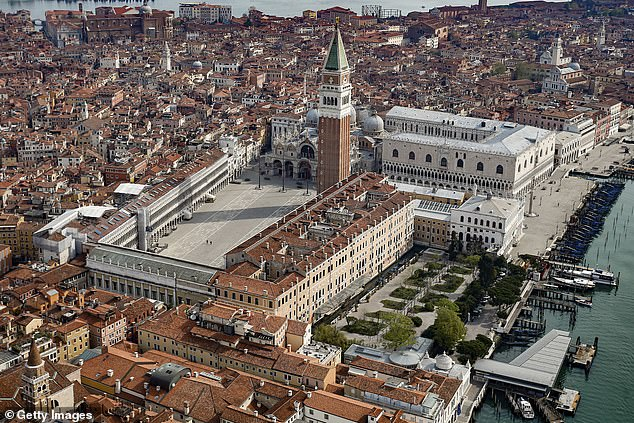 An aerial view of a helicopter from the deserted Piazza San Marco in central Venice as the Italian lockdown continues