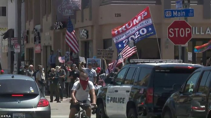 The protest was organized through social media and included people waving Trump banners on Friday