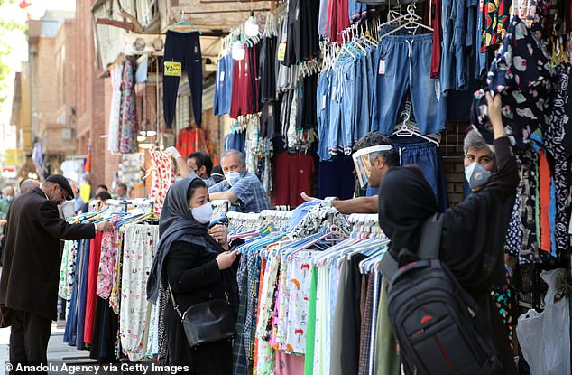 Iran took a long time to respond to the pandemic and refused to impose restrictions even after other countries forced businesses to close (photo, bazaar buyers, April 18)