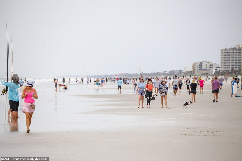Crowds came out for an overcast day Saturday and were seen enthusiastically biking, surfing, fishing and walking dogs
