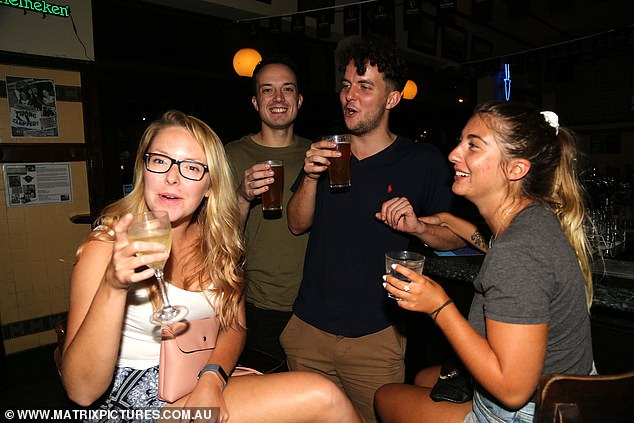A group enjoy last drinks at the Pyrmont Bridge Hotel on March 22, the last night before pubs were shut down across Australia. They could reopen with limits by July