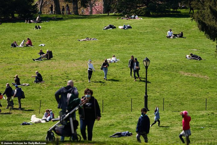 Afternoon images of temperatures reaching 61 degrees show people strolling, sometimes with less than the recommended six feet between them, and lying on the lawns