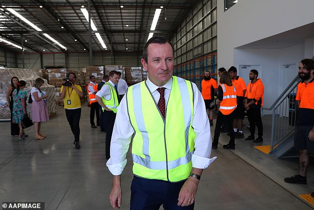 Western Australian Premier Mark McGowan (above) visits a factory on April 6 just hours before the state closed its borders to slow the spread of coronavirus